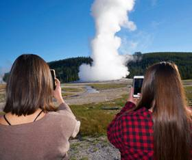 Yellowstone visitors at Old Faithful Geyser
