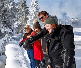 A group of Yellowstone tourists exploring the Park in winter